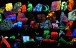 Minerals' fluorescence is a result of the transition of an electron in an atom to a lower shell